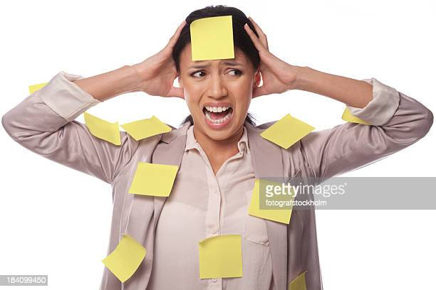 A woman covered with post its looking stressed out
