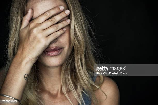 woman covering face with hand - hands covering eyes stock pictures, royalty-free photos & images