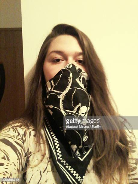 woman covering face with handkerchief - botoșani romania stock pictures, royalty-free photos & images