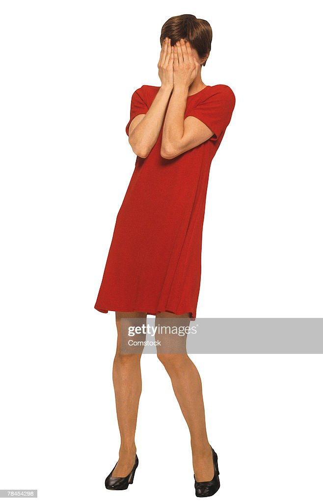Woman covering face with hands : Stock Photo