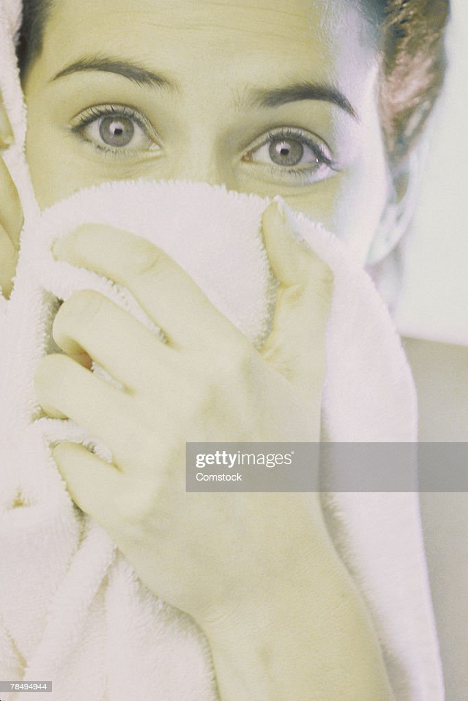 Woman covering face with towel : Stock Photo