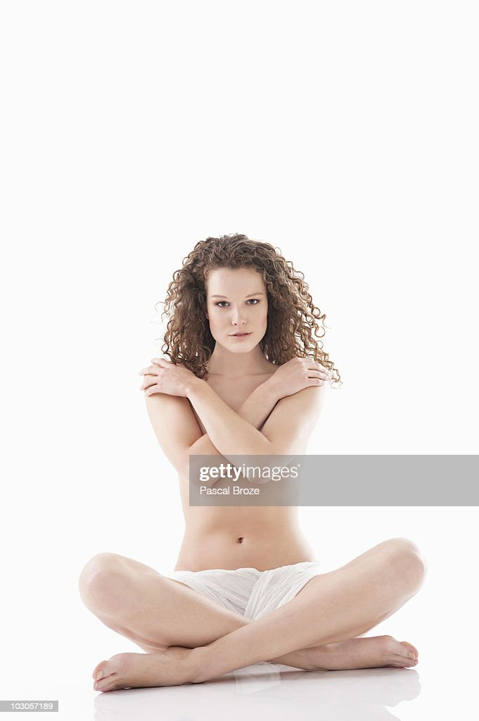 Woman covering her breasts : Stock Photo