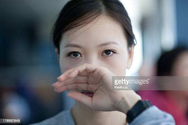 Woman covering her nose with back of hand