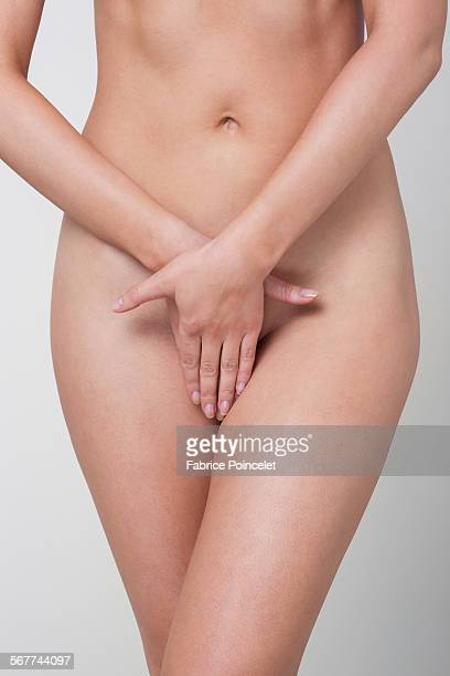 Woman covering her vagina