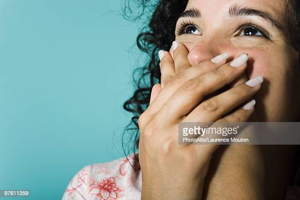 woman covering mouth with hands, portrait - embrasser stock pictures, royalty-free photos & images
