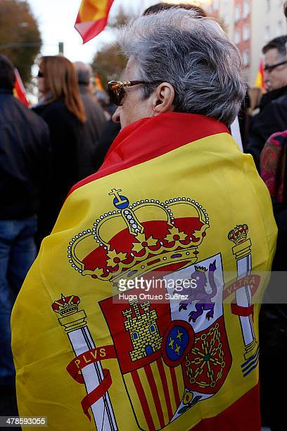Woman covers her back with a flag of Spain, during the protest against 'Parot Doctrine' which together with the failure of Strasbourg is by releasing...