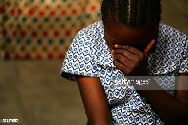 A woman covers her face as she describes her rape to a health worker March 20 2006 in Kanyabiyunga DR Congo She alleges that she was raped by three...