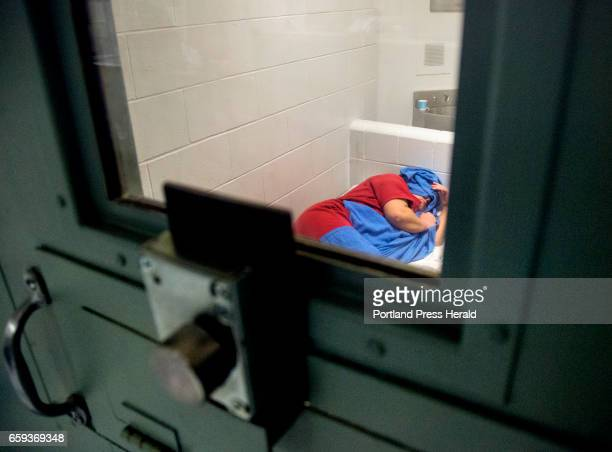 A woman covers her head in an intake cell at Cumberland County Jail on Friday March 24 2017 The woman was arrested on drug related warrants and was...
