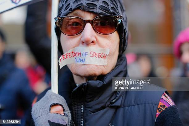 TOPSHOT A woman covers her mouth as she takes part during a protest outside the New York Times on February 26 2017 in New York The White House denied...