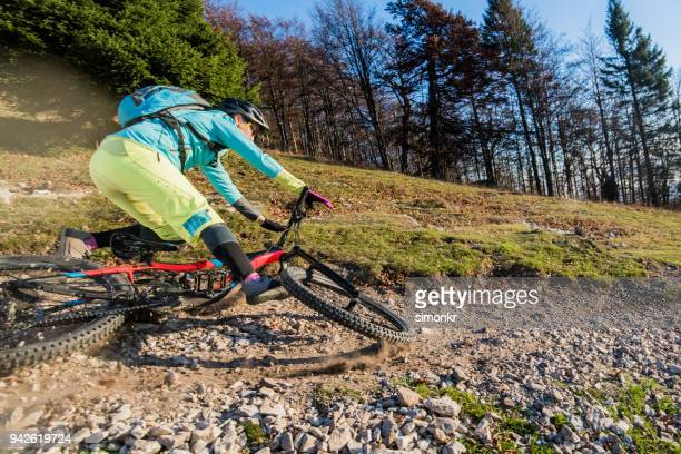 woman crashing with mountain bike - leisure equipment stock pictures, royalty-free photos & images