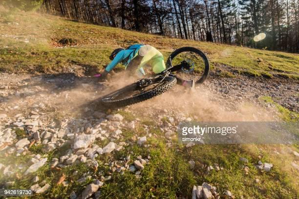 woman crashing with mountain bike - crash stock photos and pictures