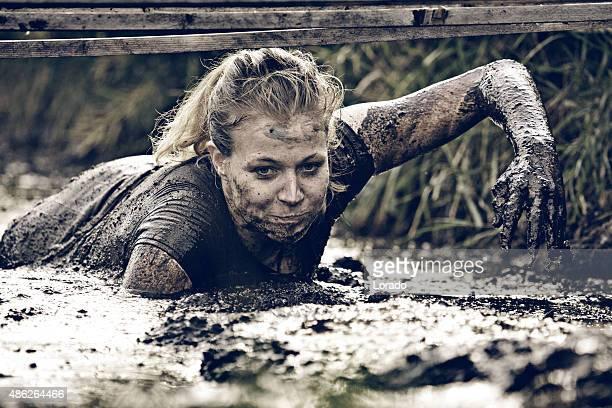 woman crawling in mud