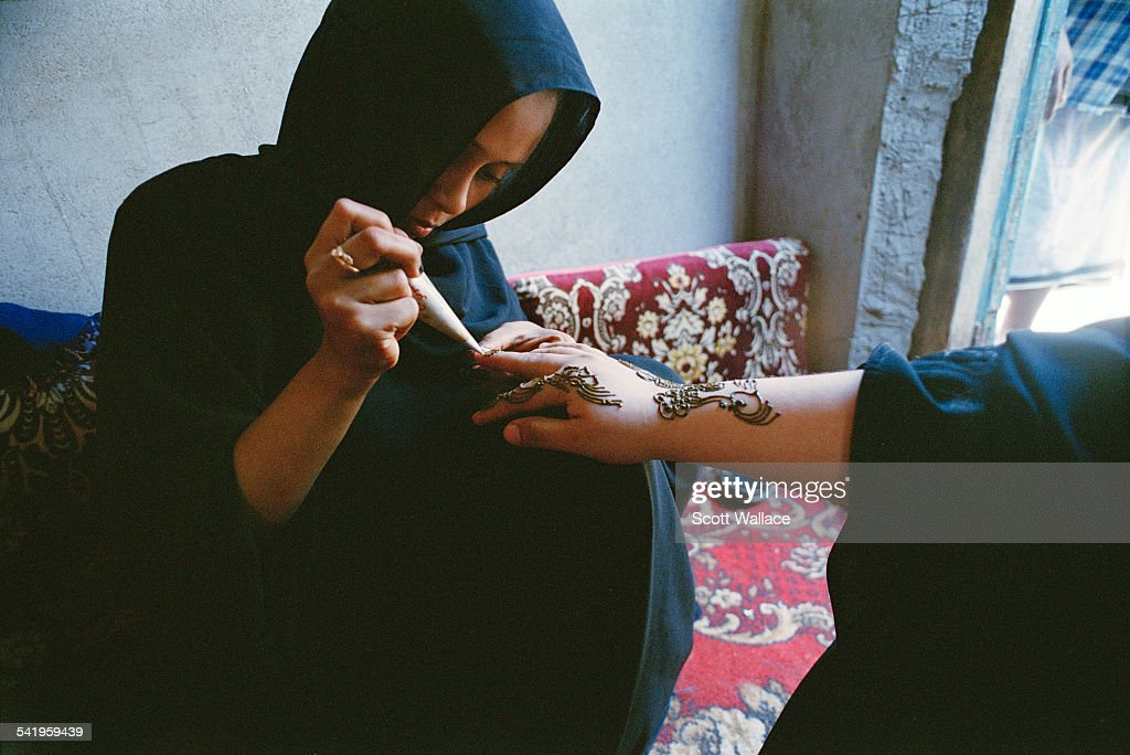 A Woman Creating A Henna Tattoo In Aden Yemen 2004 News Photo