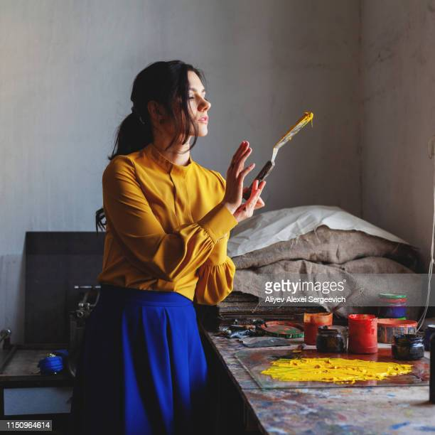 woman creating art with scraper - blouse stock pictures, royalty-free photos & images