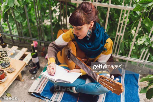 woman creating new music - guitarist stock pictures, royalty-free photos & images