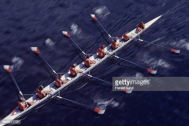 8 woman crew competitive rowing race. - sport rowing stock pictures, royalty-free photos & images
