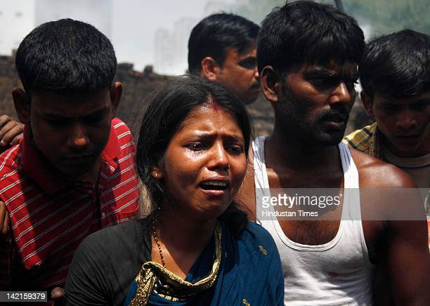Woman cries after a fire at Navada village, Sector-62 on March 31, 2012 in Noida, India. Reportedly, two children lost their lives in the major fire...