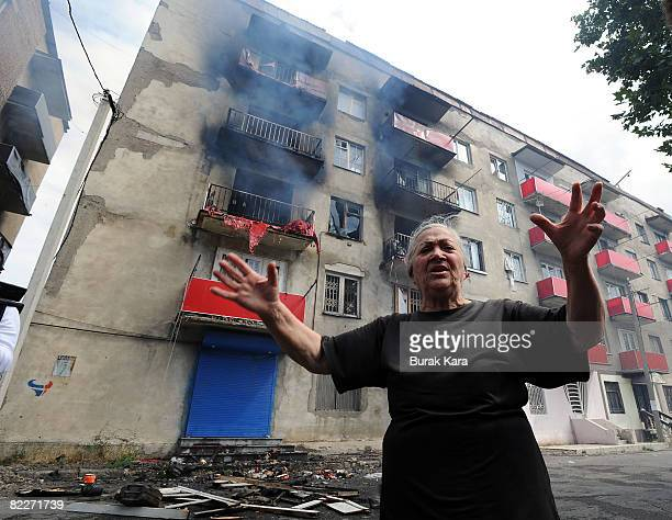 A woman cries after her house was hit by a Russian shell on August 12 2008 in Gori Georgia Russian President Dmitry Medvedev has ordered an end to...