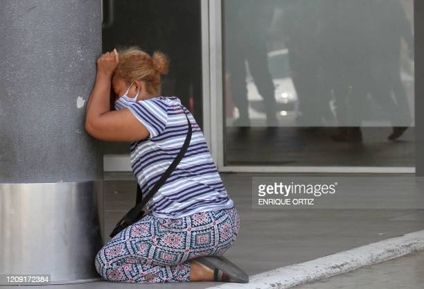 TOPSHOT A woman cries after learning about the death of a relative at Los Ceibos Hospital in Guayaquil Ecuador on April 4 2020 during the novel...
