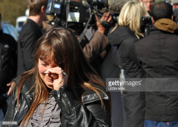 A woman cries after leaving a floral tribute outside the home of reality television personality Jade Goody on March 22 2009 after the British reality...