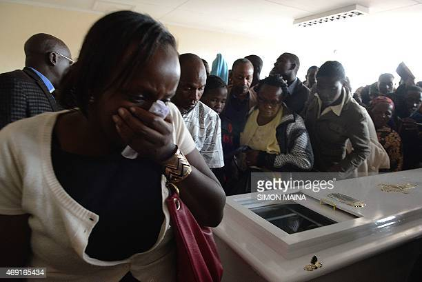 A woman cries after viewing the body of Angela Nyokabi who was killed during the attack on Garissa University at the Kenyatta University mortuary in...