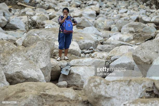 TOPSHOT A woman cries amidst the rubble left by mudslides following heavy rains in Mocoa Putumayo department southern Colombia on April 2 2017 The...