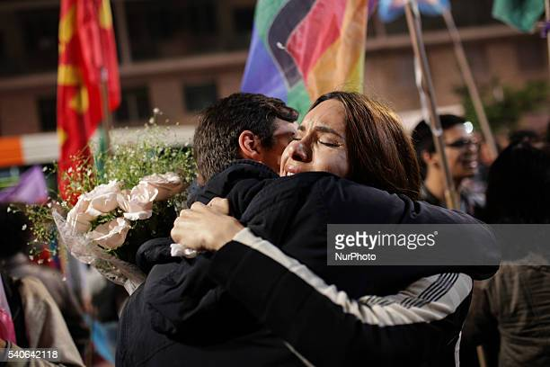 A woman cries and embrace a man during a vigil in memory of victims of the mass shooting at the Pulse gay night club in Orlando in Sao Paulo Brazil...