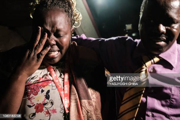 A woman cries as she is reunited with family after being evacuated from the DusitD2 compound in Nairobi after a blast followed by a gun battle rocked...