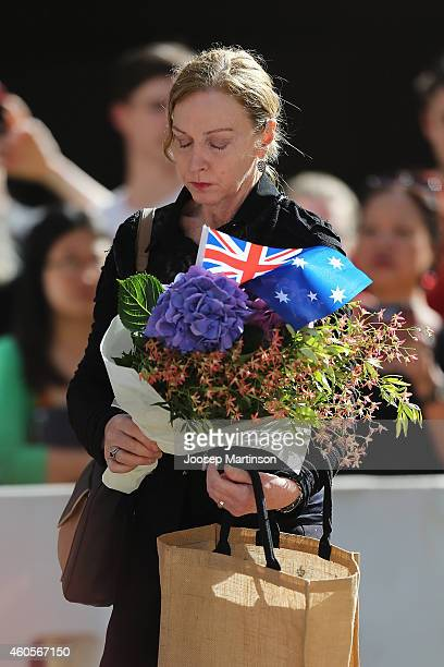 A woman cries as she pays her respect at Martin Place on December 17 2014 in Sydney Australia Sydney siege gunman Man Haron Monis was shot dead by...