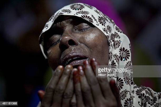 A woman cries as she prays at Baitul Mukarram the National Mosque on Eid AlFitr July 18 2015 in Dhaka Bangladesh Muslims around the world are...