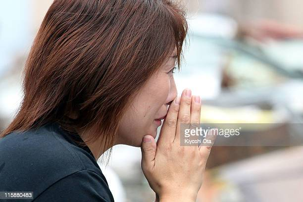 A woman cries as she prays for the earthquake and tsunami victims on June 11 2011 in Minamisanriku Miyagi Japan Japanese government has been...