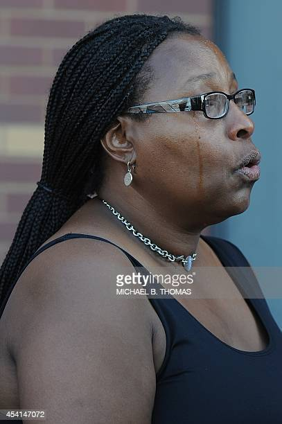 A woman cries as she sings hymns during funeral services for 18yearold Michael Brown Jr at the Friendly Temple Missionary Baptist Church in St Louis...