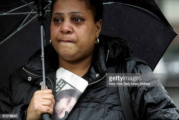A woman cries as she stands in the rain outside St Mary's Church on Grand St where the funeral for Nixzmary Brown was being held The 7yearold girl...