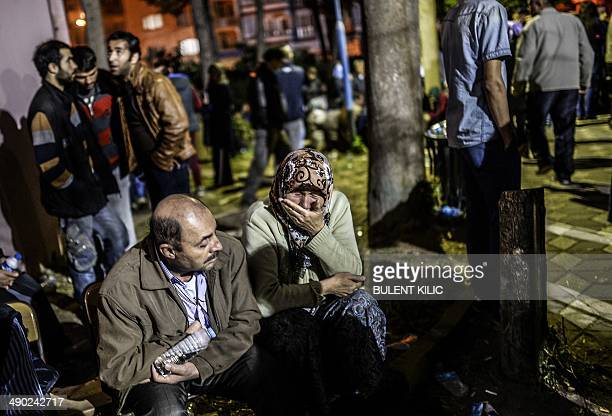 Woman cries as she waits for a news on May 14, 2014. Four miners were killed and as many as 300 trapped after a mine collapse in the western Turkish...