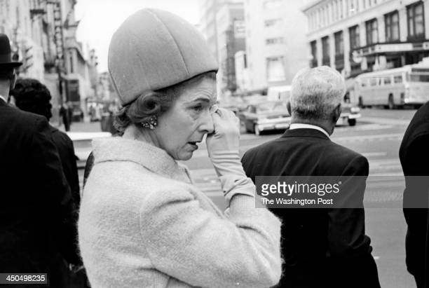 FILE A woman cries as the body of the late President John F Kennedy moves through downtown Washington DC towards Arlington National Cemetery on...