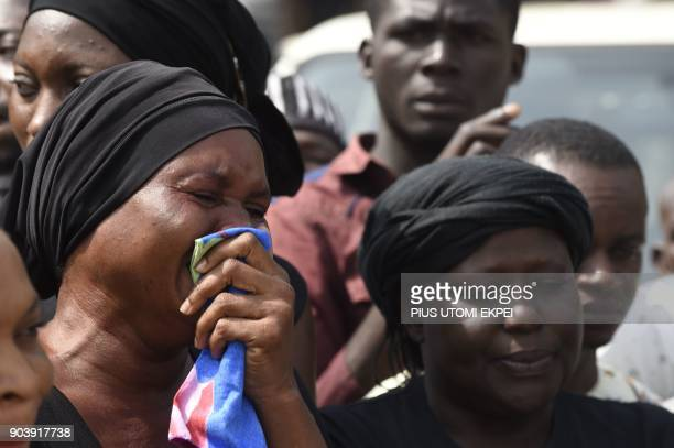 A woman cries as the casket of a relative is brought to Ibrahim Babanginda Square in the Benue State capital Makurdi on January 11 during a funeral...