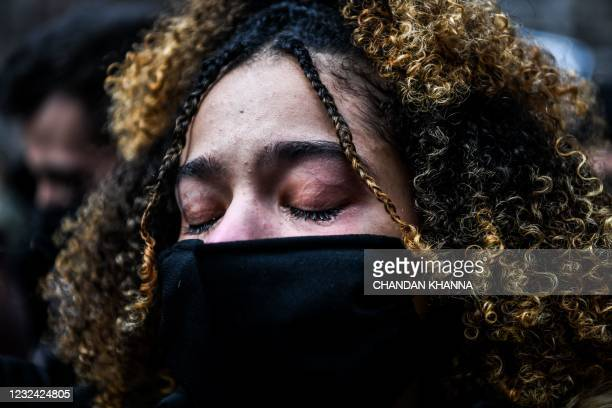 Woman cries as the verdict is announced in the trial of former police officer Derek Chauvin outside the Hennepin County Government Center in...