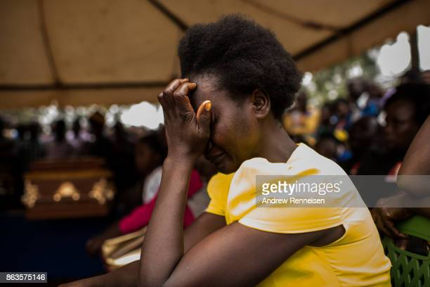 A woman cries at a funeral service for three men who were killed by the police in an opposition protest the week prior on October 20 2017 in Bondo...