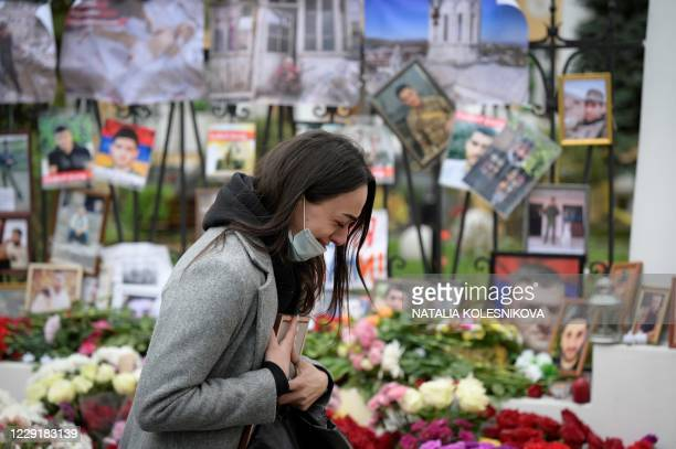 Woman cries at a makeshift memorial for Armenians killed during the military conflict with Azerbaijan over the breakaway region of Nagorno-Karabakh,...