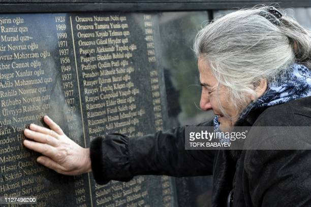 """Woman cries at Baku's """"The cry of the mother"""" monument on February 26 during a rally to mark the 27th anniversary of the Khojaly Massacre in Karabakh..."""
