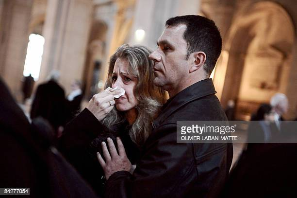A woman cries at the courthouse in Paris on January 14 after a French court cleared six health officials charged over the deaths of 117 children who...