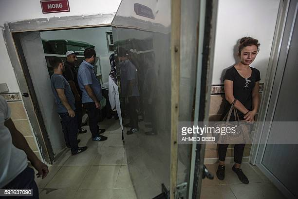 Woman cries at the morgue as she waits for the coffin of her relative, killed during last night's attack on a wedding party that left 50 dead in...