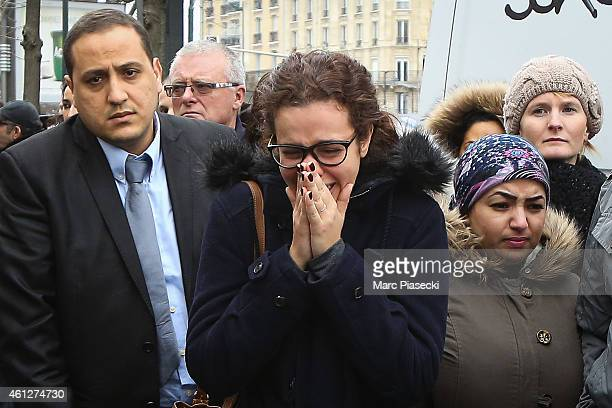 A woman cries at the site of the attack on a kosher market 'Hyper Cacher' on January 10 2015 in Paris France Four hostages and three suspects were...