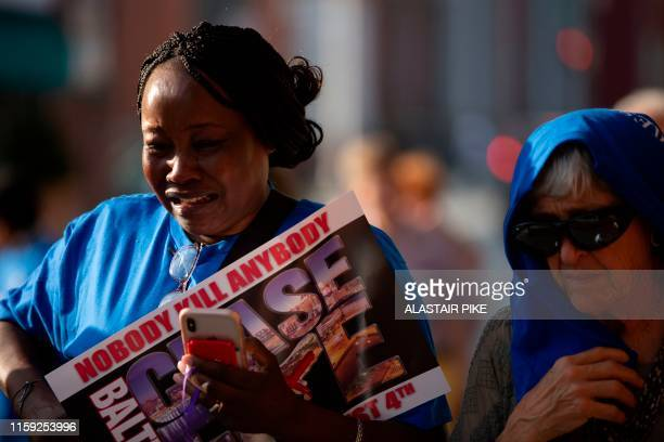 """Woman cries during a Baltimore Ceasefire """"peace walk"""" to push for a 72-hour weekend period without any homicides and commemorate victims of gun..."""