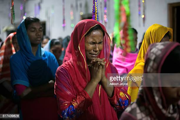 A woman cries during a church service led by Reverend Barnbash who has received death threats from ISIS at a village church March 24 2016 in Rangpur...