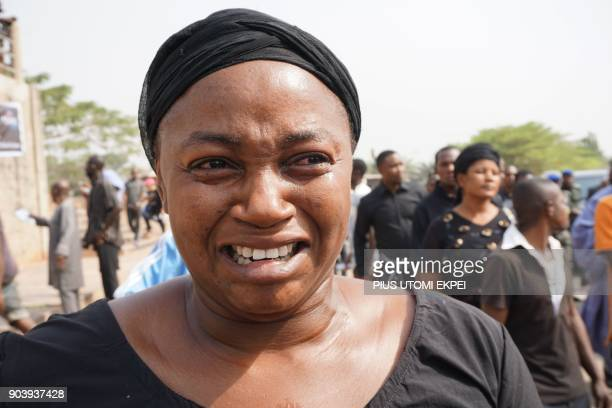 A woman cries during a mass burial for 73 persons who died following clashes between Fulani herdsmen and natives of Guma and Logo districts at...