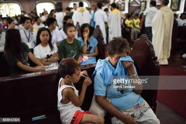 A woman cries during a mass held for victims of the drug war on February 2 2017 in Manila Philippines Philippine president Rodrigo Duterte said he...