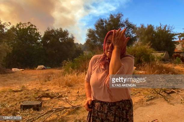 Woman cries during a massive forest fire which engulfed a Mediterranean resort region on Turkey's southern coast, near the town of Manavgat, on July...