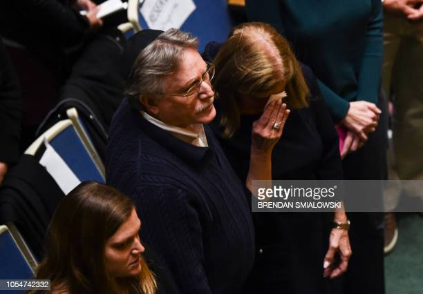 A woman cries during a vigil to remember the victims of the shooting at the Tree of Life synagogue the day before at the Allegheny County Soldiers...