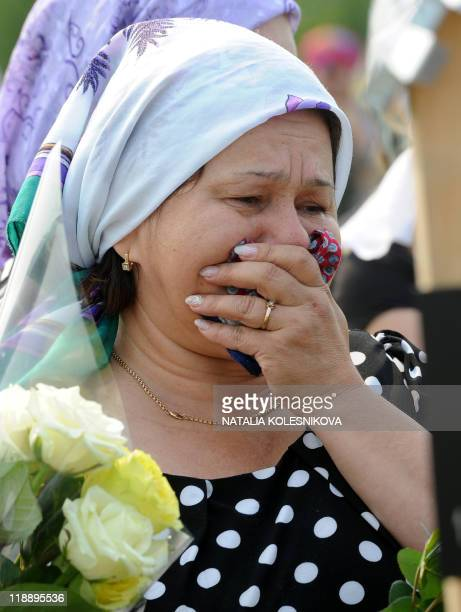 A woman cries during the funeral ceremony for Faina Valiullina one of the 116 people killed in the country's worst river disaster outside Kazan on...